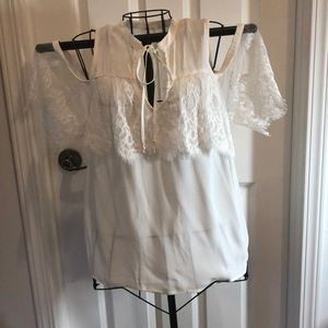 Cold shoulder top in ivory with ruffled sleeves